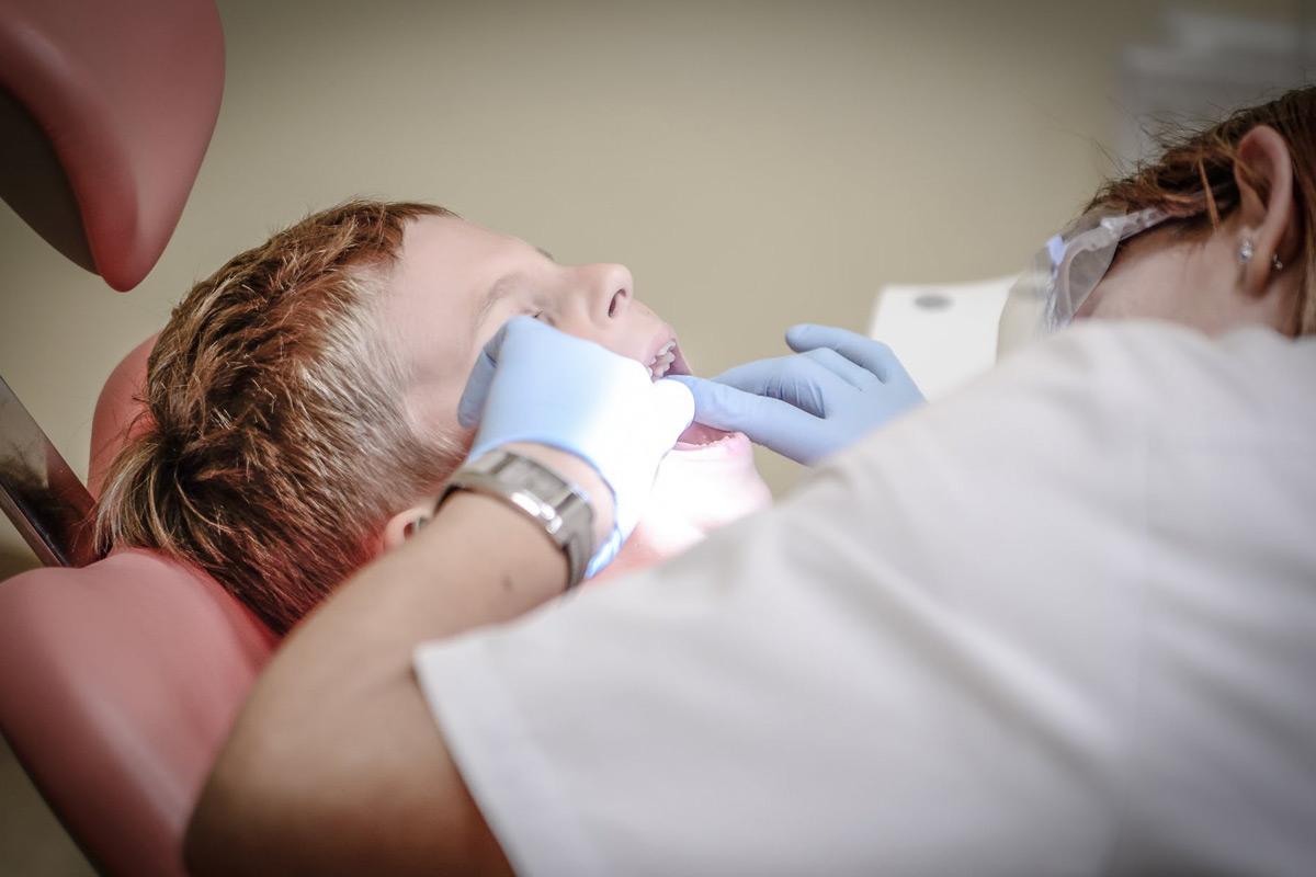 orthodontist looking after a patient